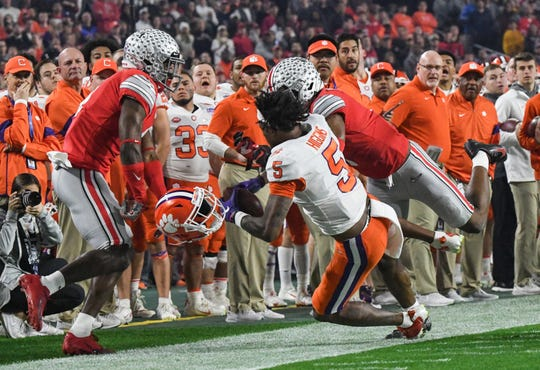 Ohio State safety Jordan Fuller(4) breaks up a pass to Clemson wide receiver Tee Higgins (5) during the first quarter of the of the PlayStation Fiesta Bowl of the College Football Playoffs semi-final game, at State Farm Stadium in Glendale, Arizona Saturday, December 28, 2019. Higgins was out of the game after the play and returned in the third quarter.