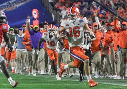 Clemson quarterback Trevor Lawrence (16) runs 67-yards for a touchdown during the second quarter of the PlayStation Fiesta Bowl of the College Football Playoffs semi-final game, at State Farm Stadium in Glendale, Arizona Saturday, December 28, 2019.