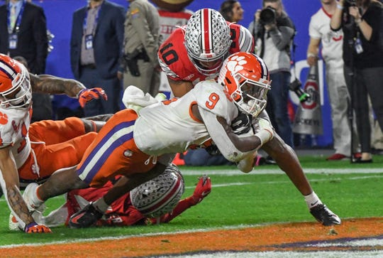 Clemson running back Travis Etienne (9) scores the go-ahead touchdown on a 34-yard catch-and-run in the Tigers' victory against Ohio State in the PlayStation Fiesta Bowl on Saturday.