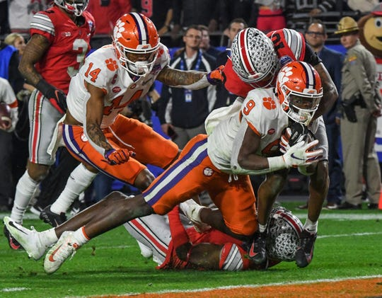 Clemson running back Travis Etienne (9) scores the go-ahead touchdown against Ohio State during the fourth quarter of the PlayStation Fiesta Bowl of the College Football Playoffs semi-final game, at State Farm Stadium in Glendale, Arizona Saturday, December 28, 2019.