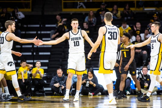 Iowa guard Joe Wieskamp (10) gets high-fives from teammates Iowa forward Riley Till, left, Iowa guard Connor McCaffery (30) and Iowa guard CJ Fredrick (5) after drawing a foul during a NCAA college men's basketball game against Kennesaw State, Sunday, Dec. 29, 2019, at Carver-Hawkeye Arena in Iowa City, Iowa.