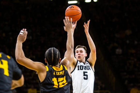CJ Fredrick makes one of his 29 3-pointers this season, against Kennesaw State last month. The freshman guard has quickly become one of the most important players for the No. 19 Hawkeyes.