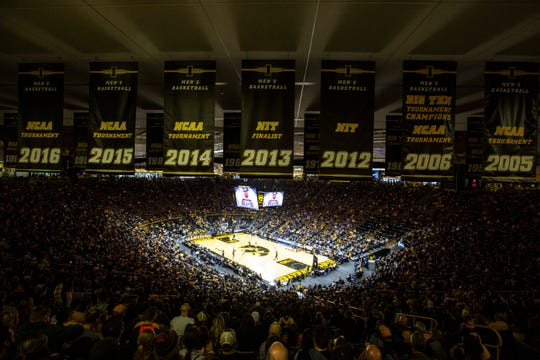 Iowa Hawkeyes men's basketball banners hang from the rafters during a NCAA college men's basketball game against Kennesaw State, Sunday, Dec. 29, 2019, at Carver-Hawkeye Arena in Iowa City, Iowa. The crowd was the first official sellout, of 15,056, of the year.