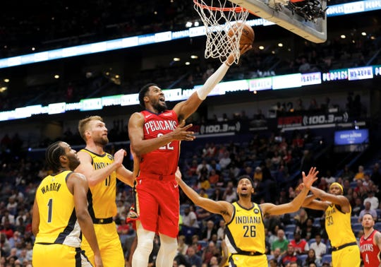 Dec 28, 2019; New Orleans, Louisiana, USA;  New Orleans Pelicans forward Derrick Favors (22) shoots over Indiana Pacers forward Domantas Sabonis (11) during the second half at the Smoothie King Center.