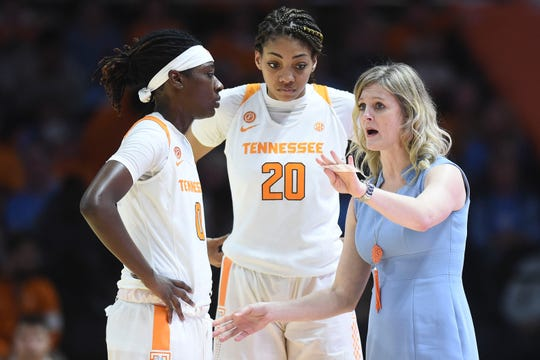 Tennessee coach Kellie Harper talks with Rennia Davis (0) and Tamari Key (20) during their game against Howard on Sunday at Thompson-Boling Arena.