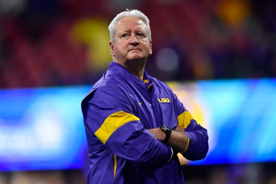 LSU offensive coordinator Steve Ensminger watches warmups before the the Peach Bowl against Oklahoma.