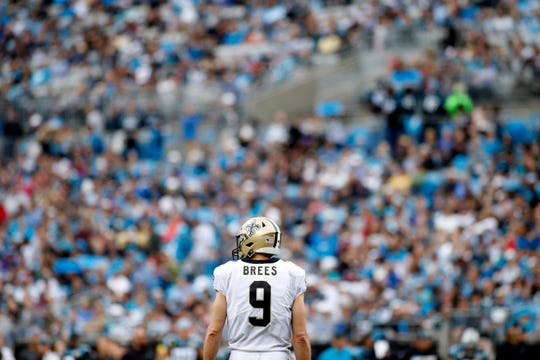 New Orleans Saints quarterback Drew Brees (9) looks on against the Carolina Panthers in Charlotte, N.C., on Sunday.