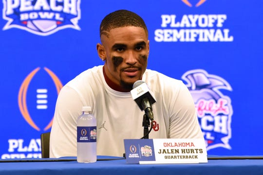 Dec 28, 2019; Atlanta, Georgia, USA; Oklahoma Sooners quarterback Jalen Hurts speaks during a press conference after the 2019 Peach Bowl college football playoff semifinal game between the LSU Tigers and the Oklahoma Sooners at Mercedes-Benz Stadium. Mandatory Credit: Dale Zanine-USA TODAY Sports