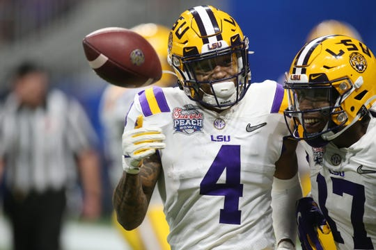 Dec 28, 2019; Atlanta, Georgia, USA; LSU Tigers running back John Emery Jr. (4) celebrates with wide receiver Racey McMath (17) after scoring a touchdown against the Oklahoma Sooners during the fourth quarter of the 2019 Peach Bowl college football playoff semifinal game at Mercedes-Benz Stadium. Mandatory Credit: Brett Davis-USA TODAY Sports