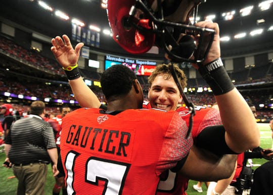 Kicker Brett Baer celebrates his game-winning field with quarterback Blaine Gautier after UL's 2011 New Orleans Bowl win over San Diego State.