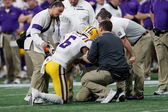 LSU wide receiver Terrace Marshall Jr. (6) is injured against Oklahoma during the second half of the Peach Bowl NCAA semifinal college football playoff game, Saturday, Dec. 28, 2019, in Atlanta. (AP Photo/John Bazemore)