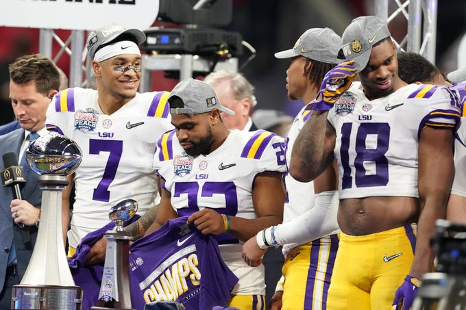 Dec 28, 2019; Atlanta, Georgia, USA; LSU Tigers safety Grant Delpit (7) and running back Clyde Edwards-Helaire (22) and linebacker K'Lavon Chaisson (18) react after defeating the Oklahoma Sooners during the fourth quarter of the 2019 Peach Bowl college football playoff semifinal game at Mercedes-Benz Stadium. Mandatory Credit: John David Mercer-USA TODAY Sports