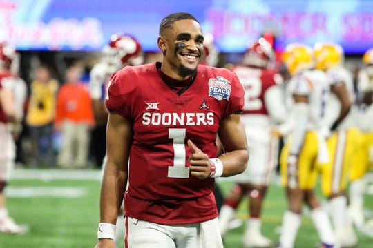 Dec 28, 2019; Atlanta, Georgia, USA; Oklahoma Sooners quarterback Jalen Hurts (1) reacts during the fourth quarter of the 2019 Peach Bowl college football playoff semifinal game between the LSU Tigers and the Oklahoma Sooners at Mercedes-Benz Stadium. Mandatory Credit: Jason Getz-USA TODAY Sports