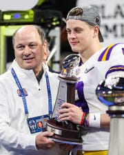 Dec 28, 2019; Atlanta, Georgia, USA; LSU Tigers quarterback Joe Burrow (9) holds the trophy after the 2019 Peach Bowl college football playoff semifinal game between the LSU Tigers and the Oklahoma Sooners at Mercedes-Benz Stadium. Mandatory Credit: Jason Getz-USA TODAY Sports