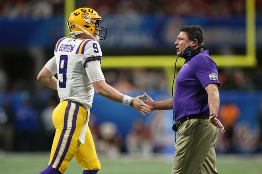 Dec 28, 2019; Atlanta, Georgia, USA; LSU Tigers quarterback Joe Burrow (9) and head coach Ed Orgeron celebrate after a Tigers touchdown against the Oklahoma Sooners during the third quarter of the 2019 Peach Bowl college football playoff semifinal game. Mandatory Credit: Brett Davis-USA TODAY Sports