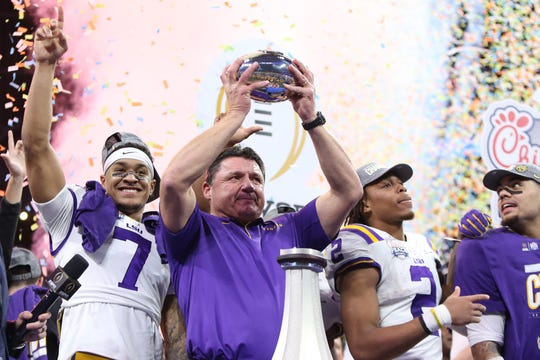 Dec 28, 2019; Atlanta, Georgia, USA; LSU Tigers head coach Ed Orgeron celebrates with safety Grant Delpit (left) and wide receiver Justin Jefferson (2) and tight end Thaddeus Moss (right) after defeating the Oklahoma Sooners in the 2019 Peach Bowl college football playoff semifinal game at Mercedes-Benz Stadium. Mandatory Credit: Brett Davis-USA TODAY Sports