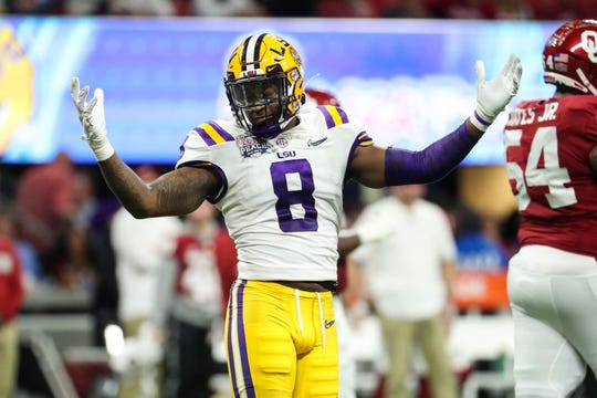 Dec 28, 2019; Atlanta, Georgia, USA; LSU Tigers linebacker Patrick Queen (8) reacts during the second quarter of the 2019 Peach Bowl college football playoff semifinal game against the Oklahoma Sooners at Mercedes-Benz Stadium. Mandatory Credit: Jason Getz-USA TODAY Sports