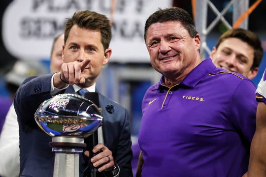 Dec 28, 2019; Atlanta, Georgia, USA; LSU Tigers head coach Ed Orgeron reacts onstage after the 2019 Peach Bowl college football playoff semifinal game between the LSU Tigers and the Oklahoma Sooners at Mercedes-Benz Stadium.