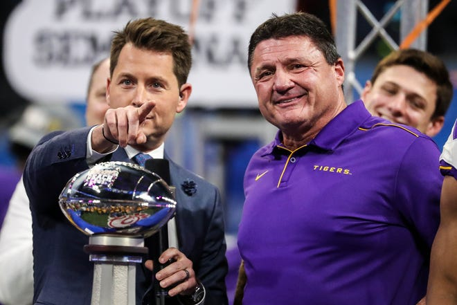 Dec 28, 2019; Atlanta, Georgia, USA; LSU Tigers head coach Ed Orgeron reacts onstage after the 2019 Peach Bowl college football playoff semifinal game between the LSU Tigers and the Oklahoma Sooners at Mercedes-Benz Stadium. Mandatory Credit: Jason Getz-USA TODAY Sports