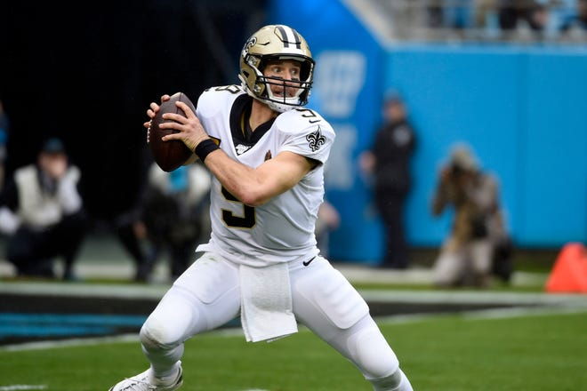 New Orleans Saints quarterback Drew Brees (9) scrambles during the first half of an NFL football game against the Carolina Panthers in Charlotte, N.C., Sunday, Dec. 29, 2019. (AP Photo/Mike McCarn)