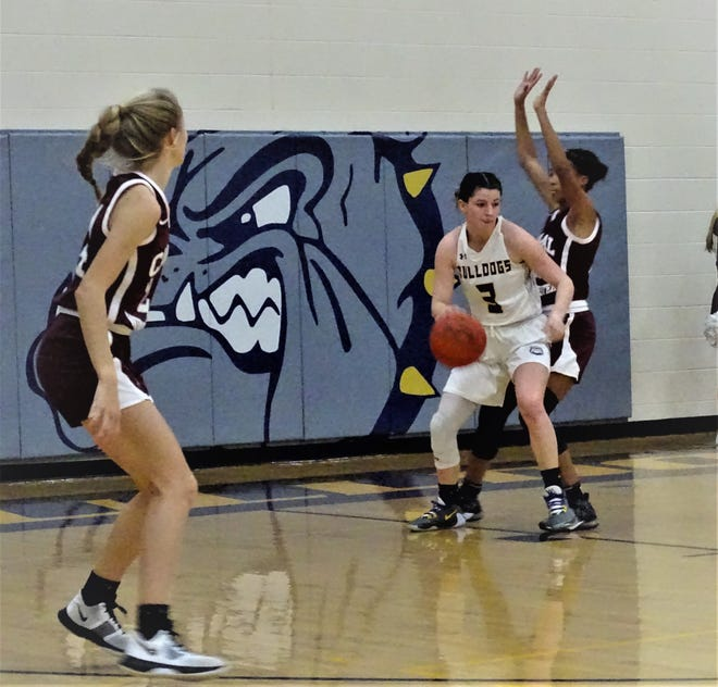 Bloom-Carroll's Makenzee Mason gets set to make a move in the paint against Canal Winchester on Saturday. Mason finished with a career-high 24 points, but it wasn't enough in a 59-48 loss.