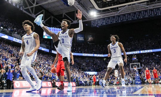 Kentucky's Ashton Hagans had an emphatic dunk at the end of the game to put the exclamation mark on the Wildcats' 78-70 win over Louisville at Rupp Arena Saturday in Lexington. Dec. 28, 2019