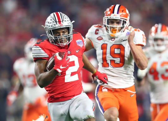 Ohio State tailback J.K. Dobbins runs for a 68-yard touchdown in the first quarter of Saturday's 29-23 loss to Clemson in the College Football Playoff semifinal at the Fiesta Bowl.