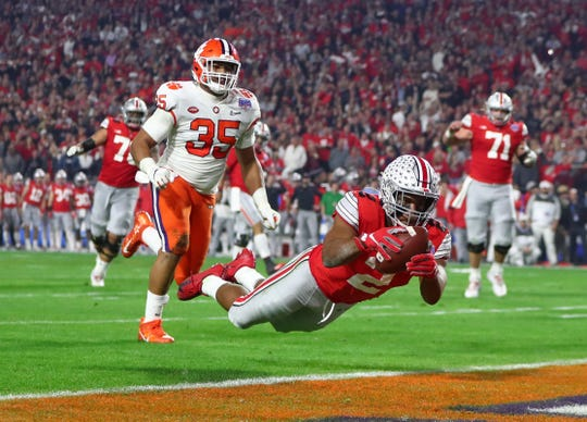 Ohio State running back J.K. Dobbins dives to make a touchdown catch in Saturday's College Football Playoff semifinal against Clemson. On the field, it was ruled a catch.  But it was overturned by replay and ruled an incompletion. It was one of three replay reviews that did not go OSU's way, two of them costing the Buckeyes touchdowns.