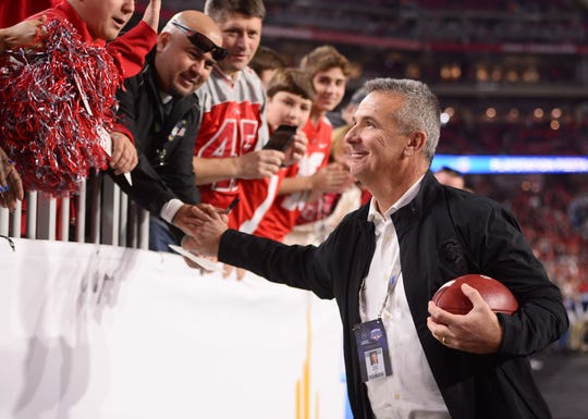 Former Ohio State coach Urban Meyer greets fans before the Buckeyes' 29-23 loss to Clemson in a College Football Playoff semifinal at the Fiesta Bowl.