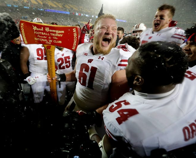 Wisconsin center Tyler Biadasz, holding Paul Bunyan's Axe, will likely be playing his final game for the Badgers in the Rose Bowl.