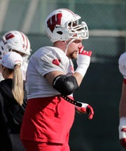 Badgers offensive lineman David Moorman takes a break Saturday during practice for the Rose Bowl in Los Angeles.