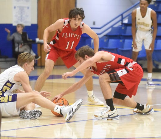 Flippin's Preston Belding and Even Riggs battle Junction City's Ryan Allen for a loose ball on Saturday.