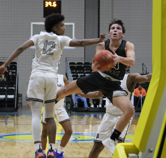 Izard County's Coby Everett goes in for a layup against St. Francis, Georgia, during action at the Beach Ball Classic in Myrtle Beach, S.C.