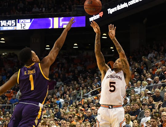 Auburn guard J'Von McCormick (5) shoots against Lipscomb on Sunday, December 29, 2019 in Auburn, Ala.