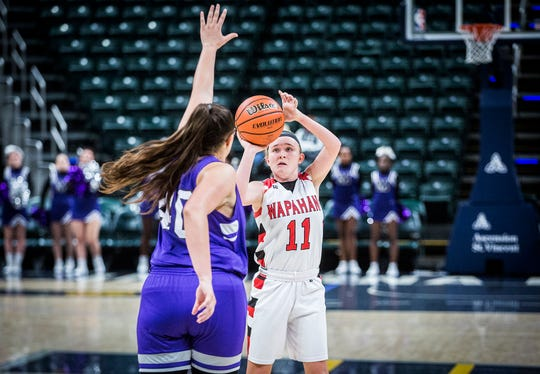 FILE -- Wapahani's Madison Thompson looks to shoot against Central's defense during The Really Big Basketball Holiday Show at Banker's Life Fieldhouse Saturday, Dec. 28, 2019.