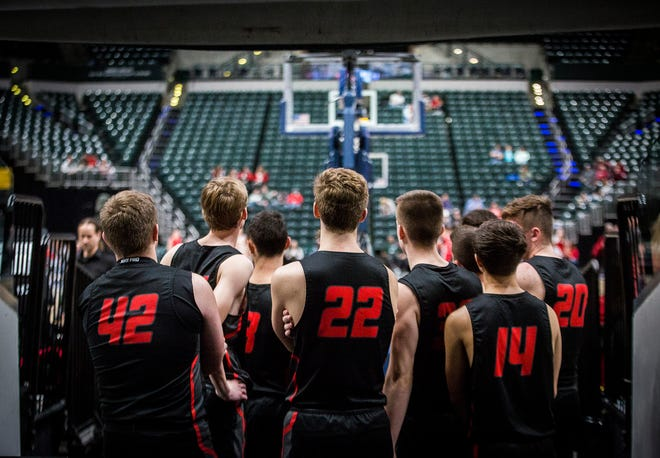 FILE -- For the first time ever, the IHSAA boys basketball state tournament was canceled on March 19, 2020 due to the coronavirus closing schools across the state of Indiana. Area teams Blackford, Blue River, Cowan, Delta and Wapahani all finished their seasons with sectional championship victories.