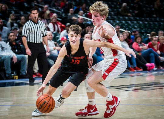 Wapahani's Evan Rausch slips past Frankton's defense during The Really Big Basketball Holiday Show at Banker's Life Fieldhouse Saturday, Dec. 28, 2019.