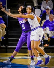 MTSU's Charity Savage (35) defends against TCU's Yummy Morris (5). Savage finished the game with a career-high 22 rebounds.