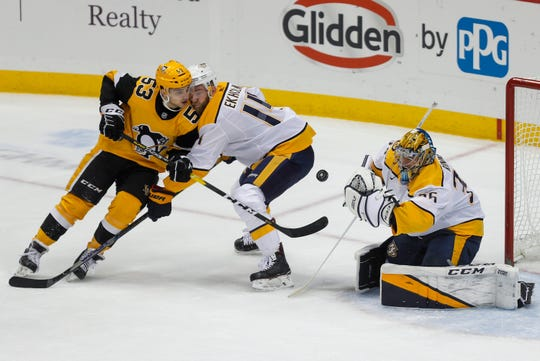 Dec. 28, 2019 -- Penguins 6, Predators 4 -- Nashville Predators goaltender Pekka Rinne stops a shot by Pittsburgh Penguins' Teddy Blueger (53) as Mattias Ekholm (14) defends during the first period Saturday, Dec. 28, 2019, in Pittsburgh.