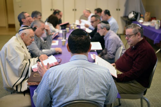 A daf yomi group at Congregation Keter Torah studies a page of the Talmud on Sunday morning, December 29, 2019. For almost seven and a half years straight, Jews around the world have been reading the Talmud, cover to cover, a page at a time.