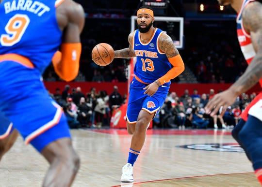 Dec 28, 2019; Washington, District of Columbia, USA; New York Knicks forward Marcus Morris Sr. (13) dribbles the ball against the Washington Wizards during the first quarter at Capital One Arena.