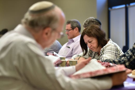 Gail Licht attends a daf yomi group at Congregation Keter Torah on Sunday morning, December 29, 2019. For almost seven and a half years straight, Jews around the world have been reading the Talmud, cover to cover, a page at a time.