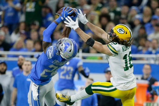 Detroit Lions cornerback Amani Oruwariye (24) intercepts a pass intended for Green Bay Packers wide receiver Jake Kumerow (16) during the second half of an NFL football game, Sunday, Dec. 29, 2019, in Detroit.