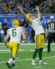 Green Bay Packers kicker Mason Crosby (2) raises his arms after kicking the winning field goal during the second half of an NFL football game against the Detroit Lions, Sunday, Dec. 29, 2019, in Detroit.
