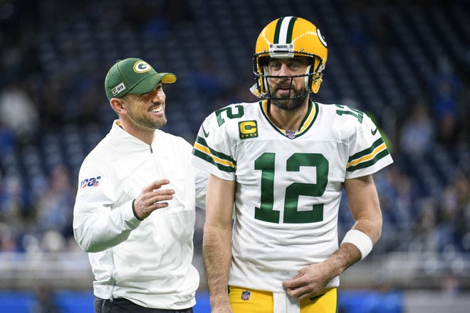 Packers head coach Matt LaFleur and quarterback Aaron Rodgers before the game against the Detroit Lions at Ford Field.