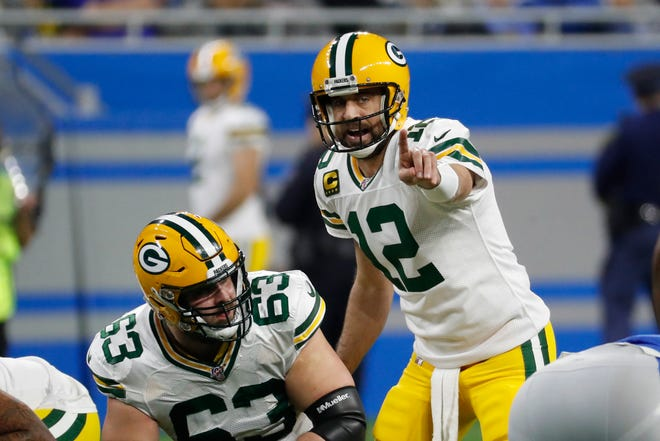 Green Bay Packers quarterback Aaron Rodgers calls out signals during the first half of an NFL football game against the Detroit Lions, Sunday, Dec. 29, 2019, in Detroit.