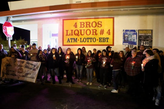Friends and family gather for a candlelight vigil for Alex Ryan Marcotte on the one-year anniversary of his death in Banning, Calif., on Saturday, December 28, 2019.