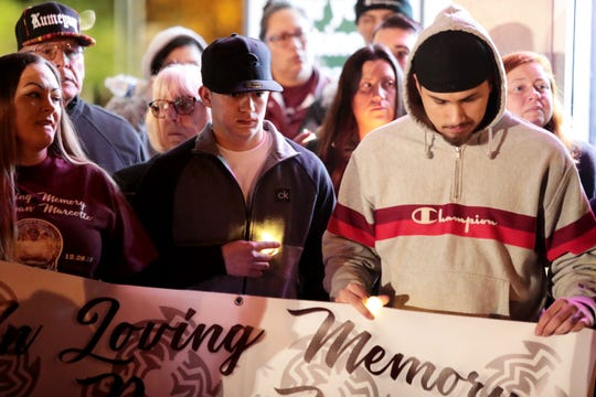 Friends and family gather for a candlelight vigil for Alex Ryan Marcotte on the one-year anniversary of his death in Banning,Calif., on Saturday, December 28, 2019.