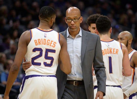 Phoenix Suns head coach Monty Williams, center talks with forward Mikal Bridges, left, during the first quarter of an NBA basketball game against the Sacramento Kings in Sacramento, Calif., Saturday, Dec. 28, 2019. (AP Photo/Hector Amezcua)