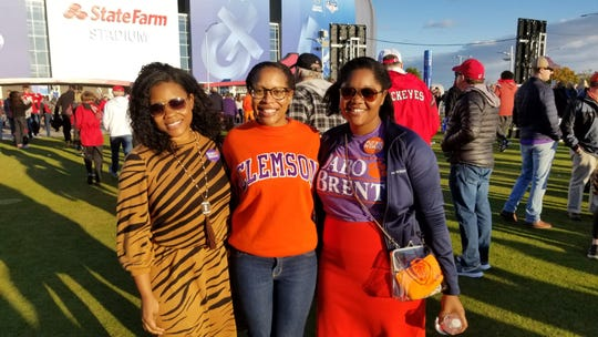 Leah Geer, Anna Williams and Amy Moon traveled to the Valley from South Carolina to cheer on the Clemson Tigers at the PlayStation Fiesta Bowl on Dec. 28, 2019.